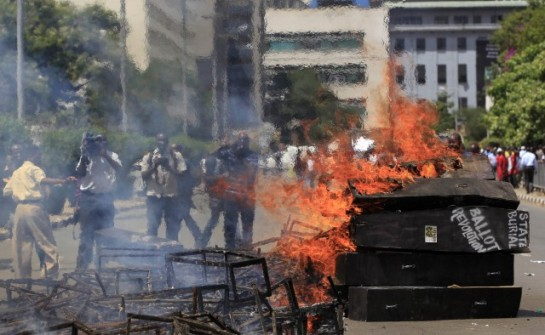 Mock coffins burn outside the Kenyan parliament during a protest in Nairobi. REUTERS/Thomas Mukoya